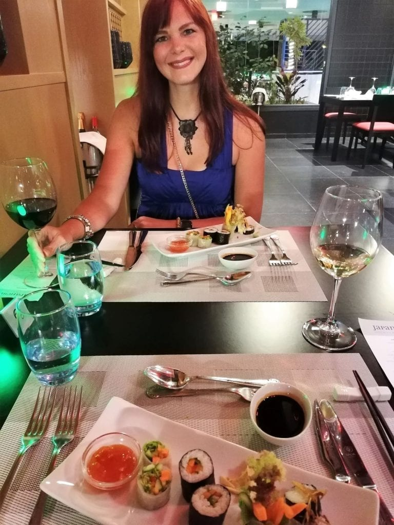 Enjoying specially prepared vegetarian Japanese sushi at our hotel in the maldives with a generous glass of red wine