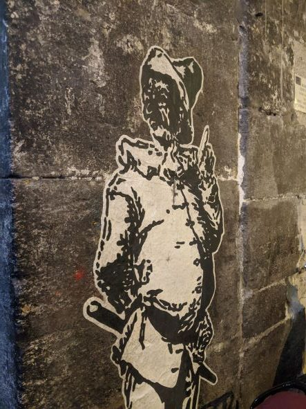 Things to do in Naples - Italian white and black street art of a traditional looking man