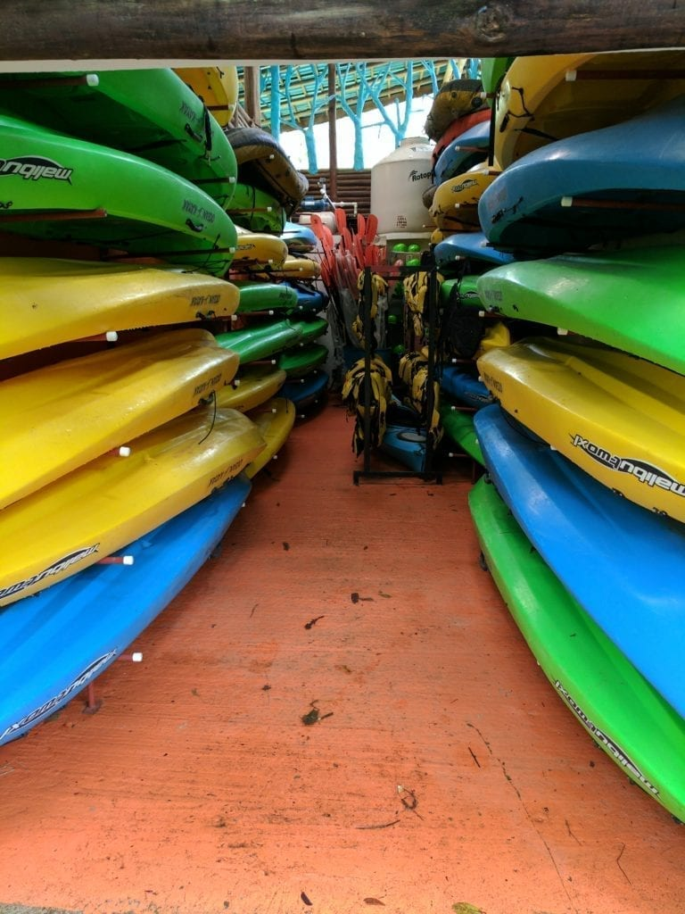 Costa Rica Itinerary - a room filled with colourful kayaks in Sarapiqui