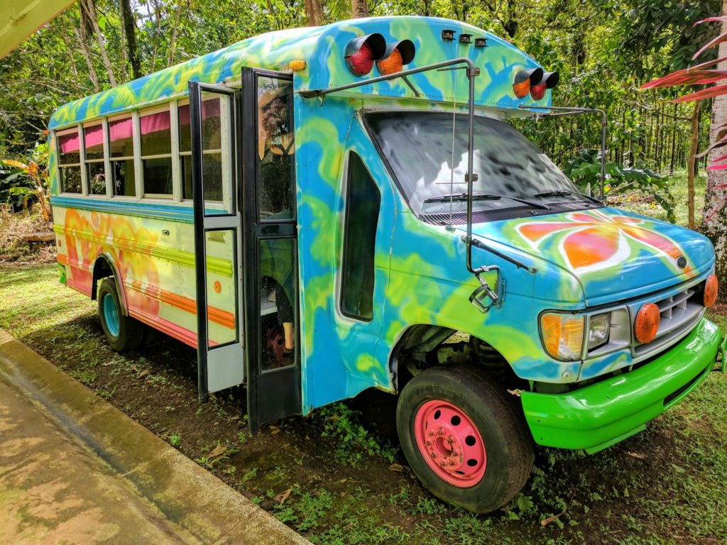Costa Rica Itinerary - A colourful patterned group tour bus in Sarapiqui