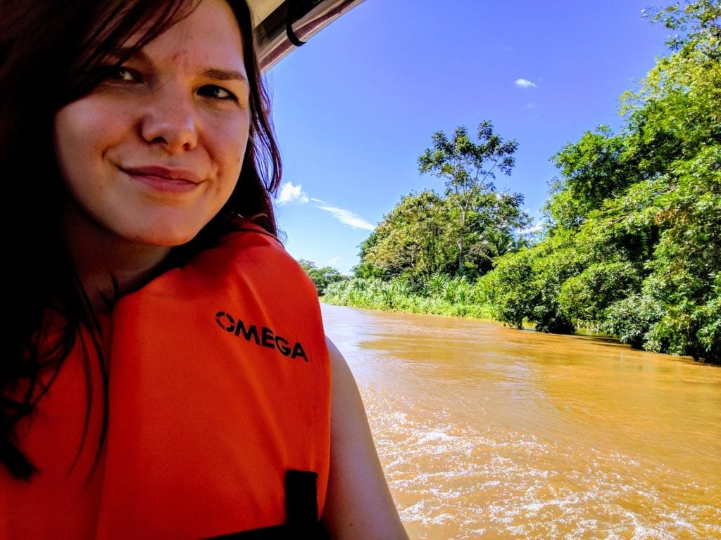 Costa Rica Itinerary - woman in lifejacket enjoying a boat taxi on Tortuguero river