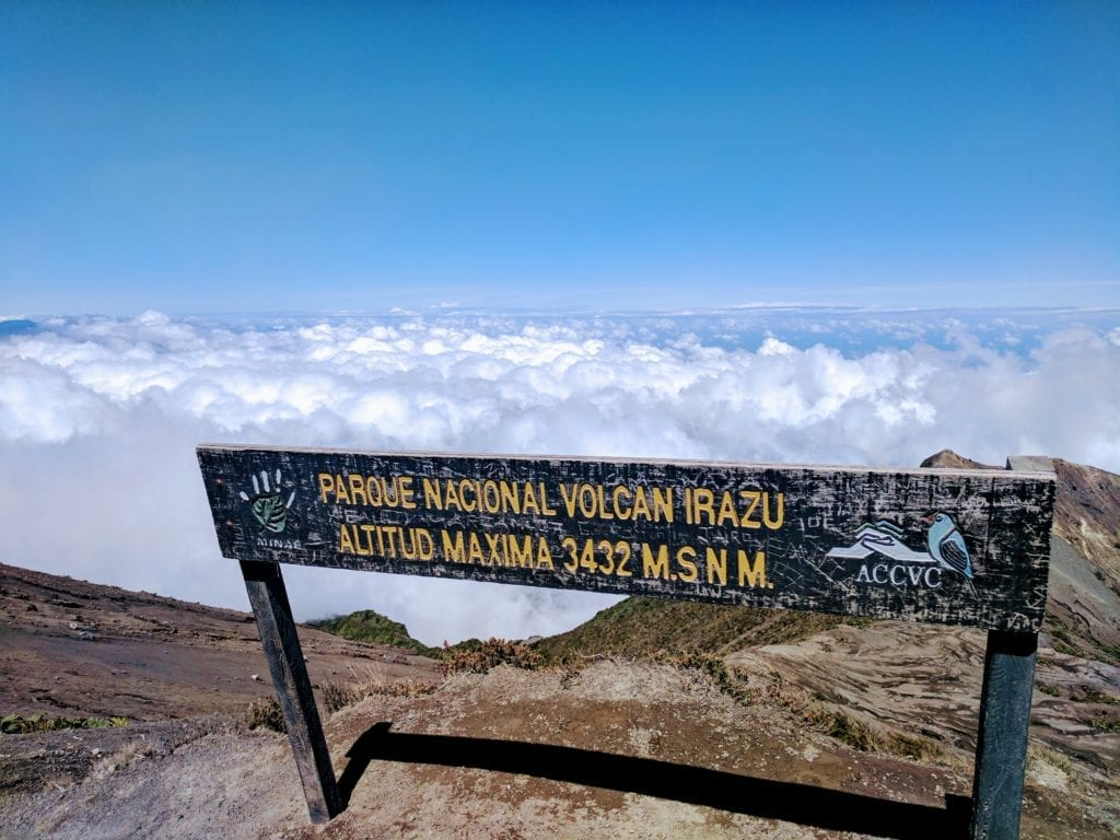 Costa Rica Itinerary - Sign on the peak of Irazu volcano above the clouds