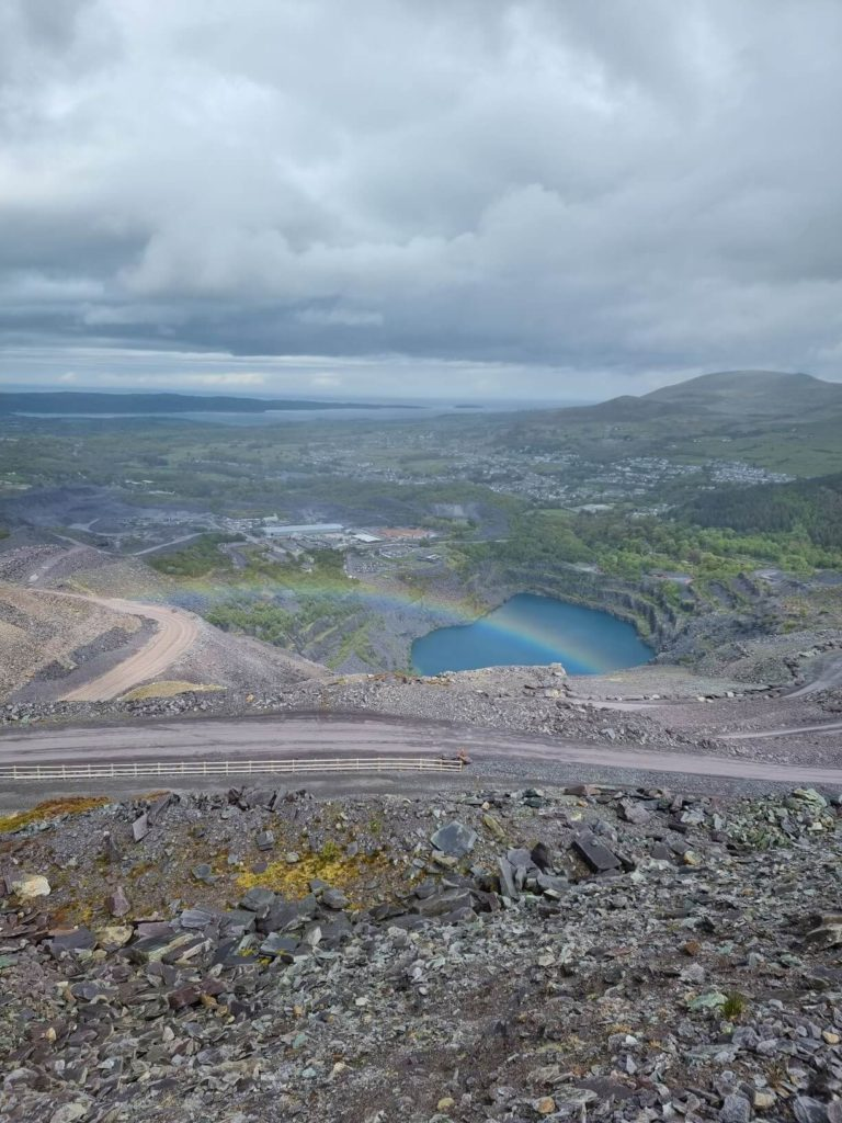 Zip World Karts - the view from the top of the quarry looking down at the blue lagoon at the bottom of the track