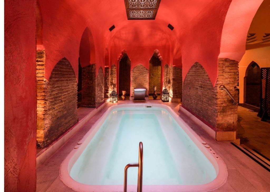 Epic things to do in Marrakech - lavish hamman public bath in red clay stone morrocan infused spa