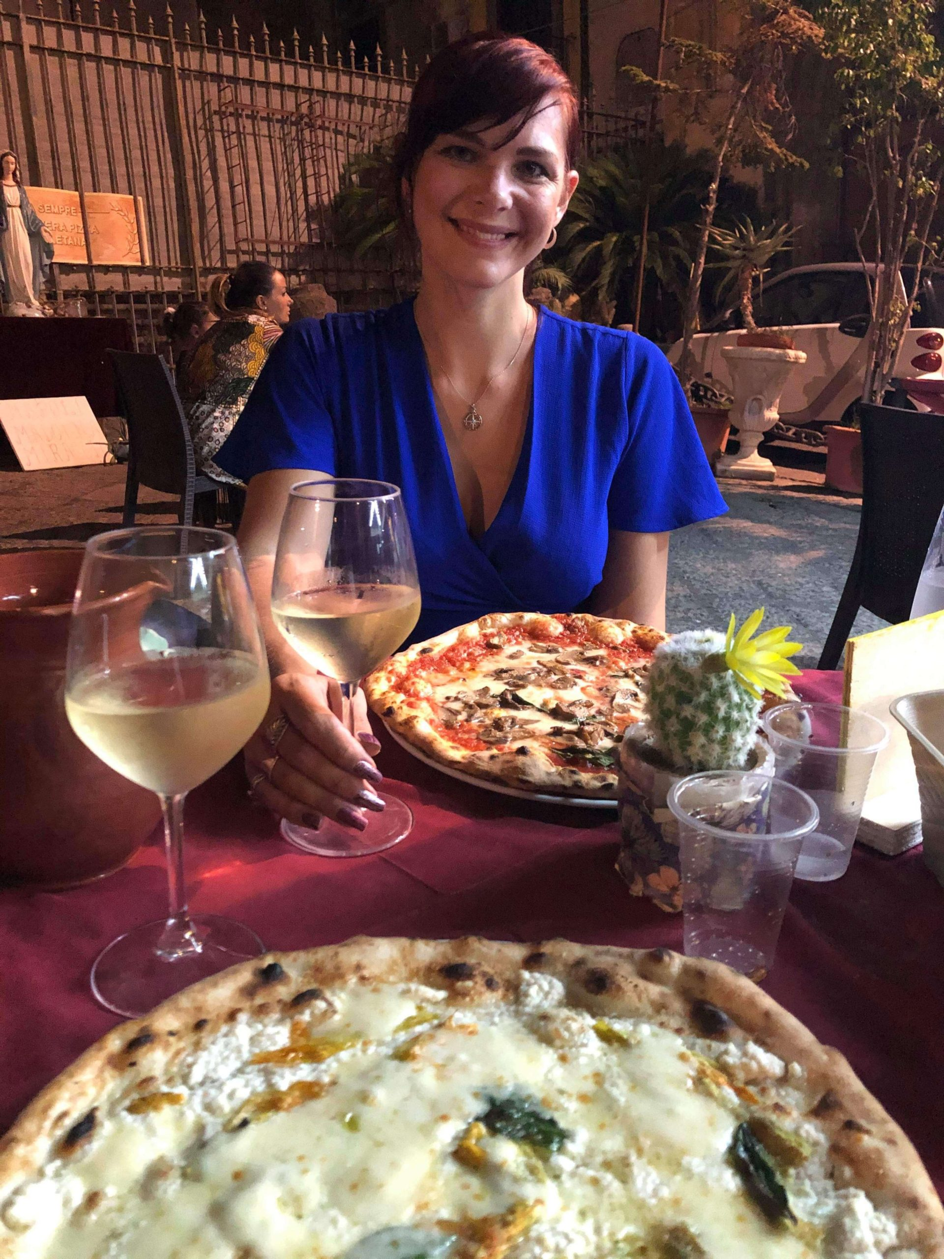 Things to do in Naples - woman eating a pizza in a pizzeria