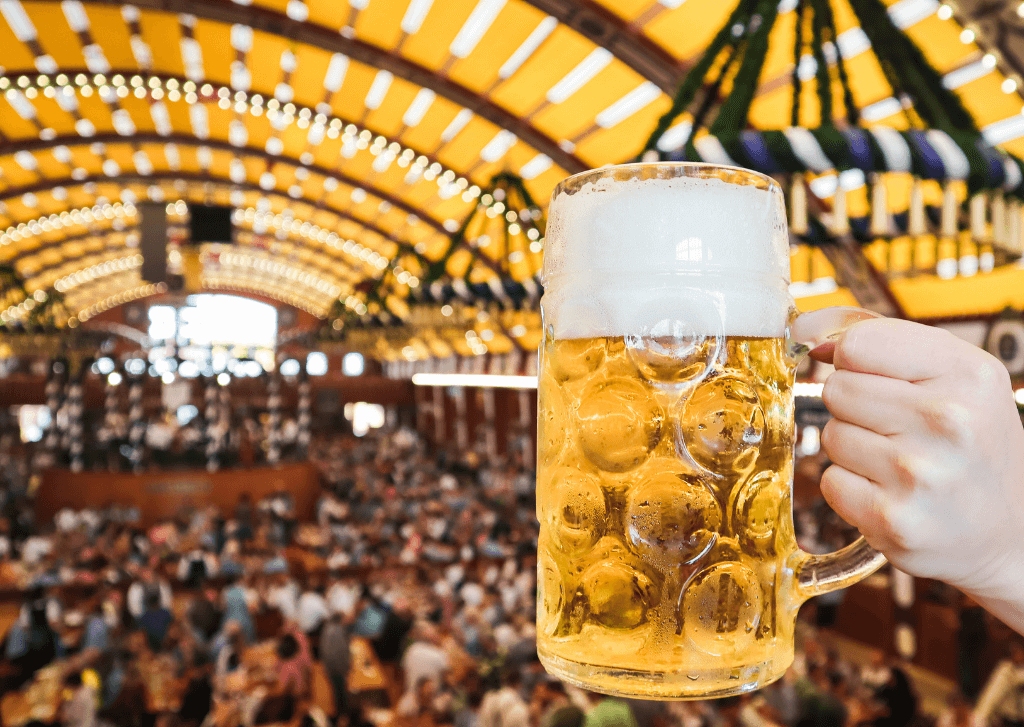 Munich beer festival tent - raising a stein of lager